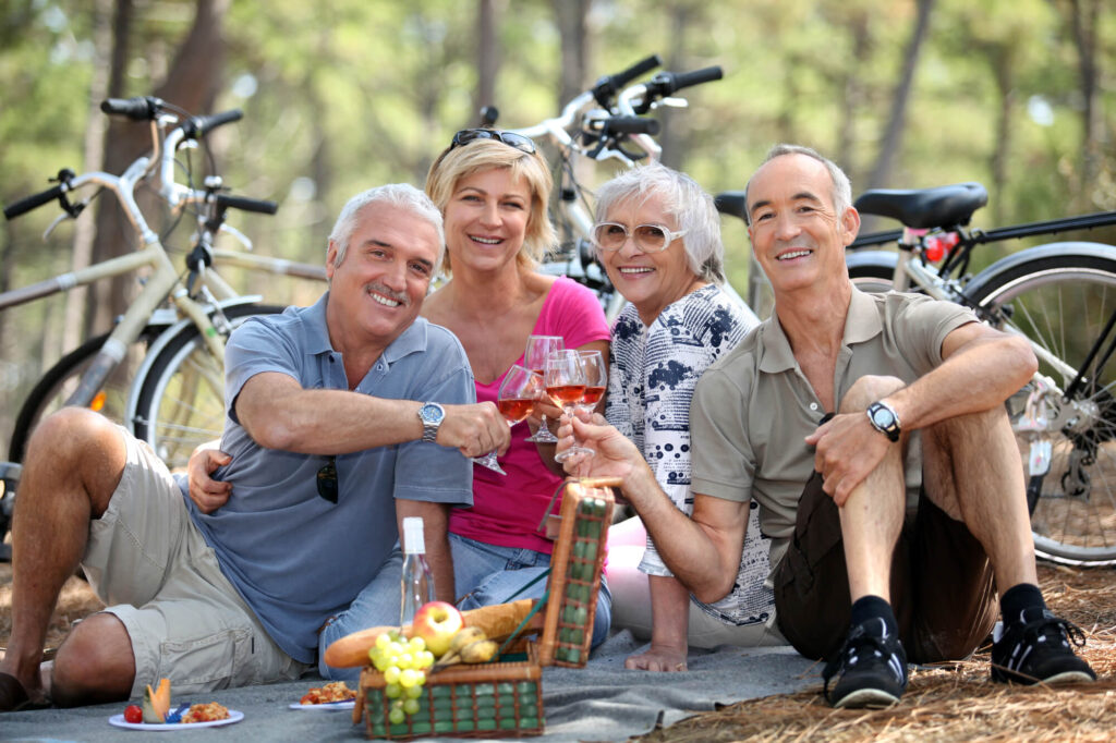 Two older couples enjoying a picnic