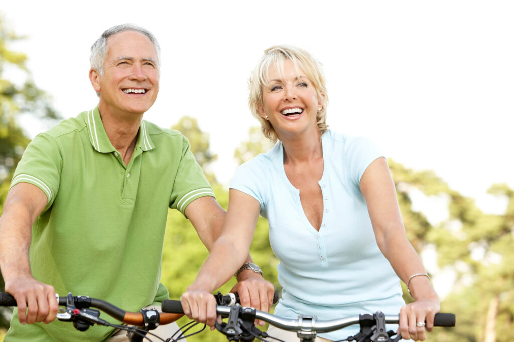 couple over 50 on bicycles